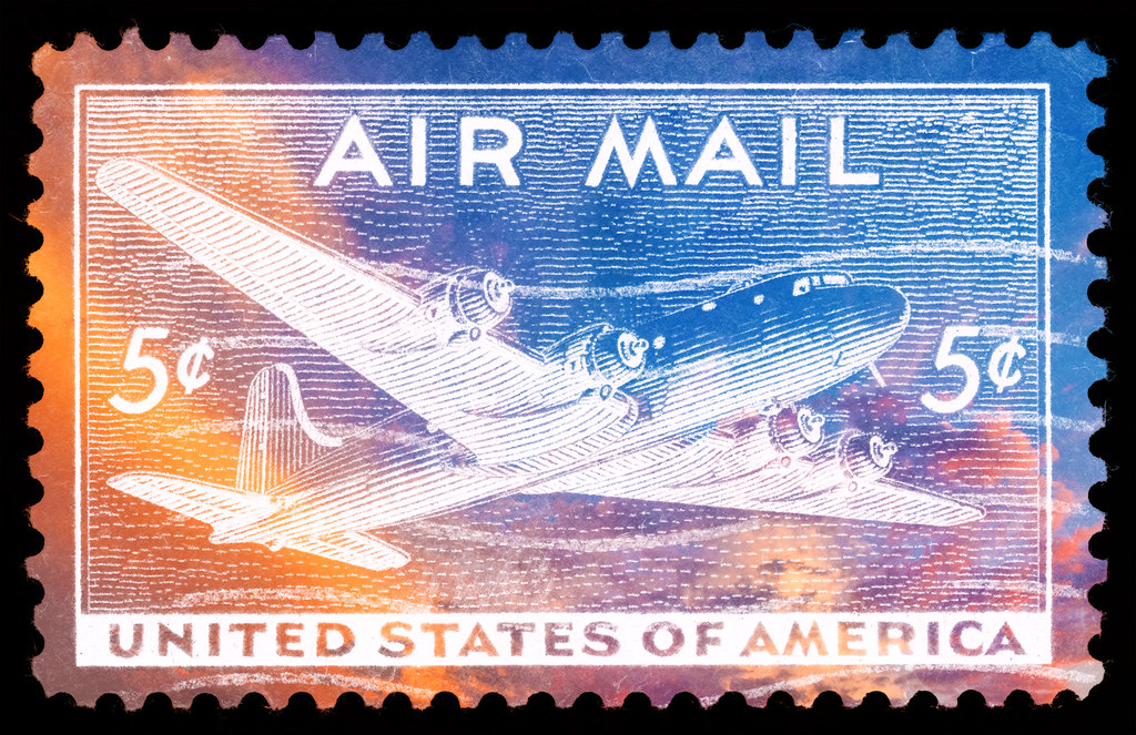 Photomanipulated vintage Air Mail Stamp combined with a photo of vibrant sunset clouds