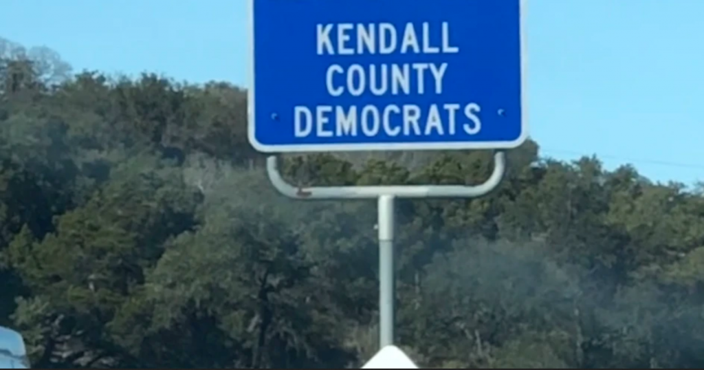 Kendall County Democrats adopt-a-highway sign