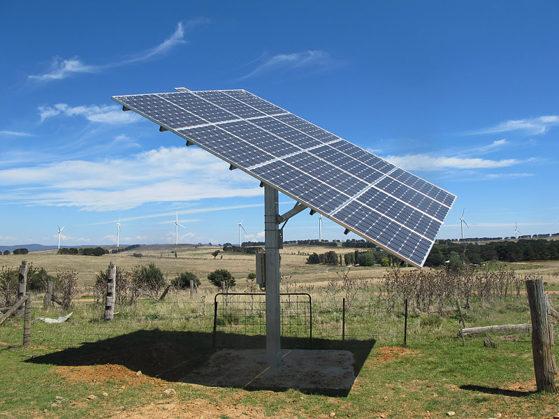 Solar panel with Wind Turbines in the background