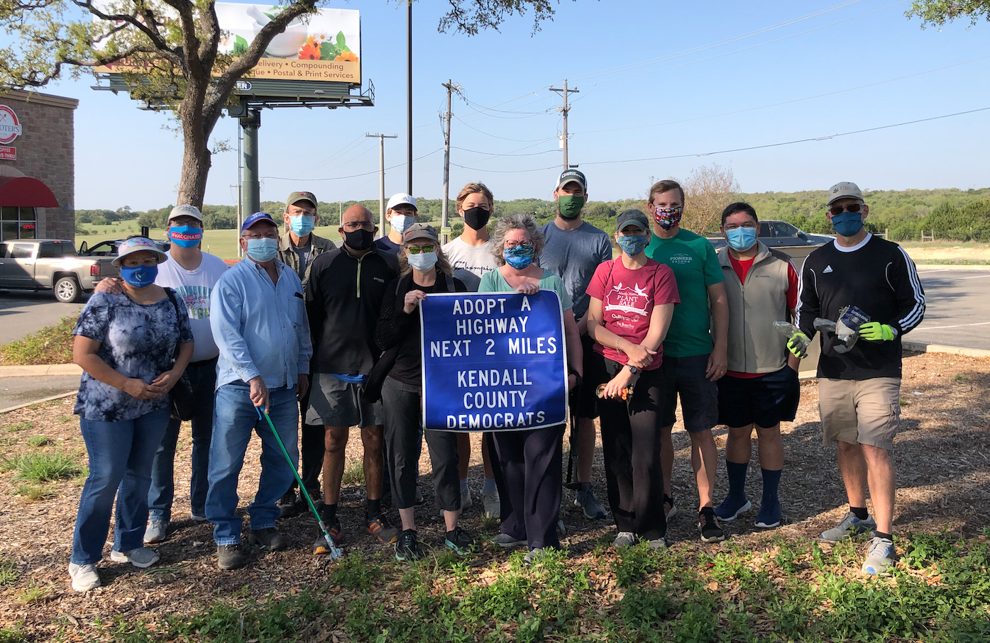 """Group photo with the """"Adopt-a-Highway"""" sign"""